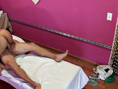 Busty asian tugging masseuse with client
