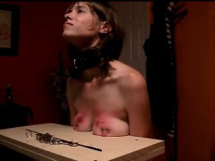 Nailing her breasts towards the table 2