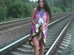 Indian amateur lass gently blows lad's rod on the railways