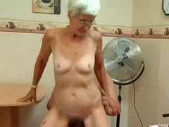 Granny takes her Teeth out for a fine Blow