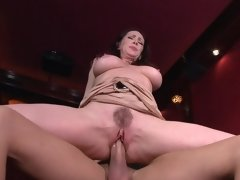 Cougar in the movie theater sits on his big cock