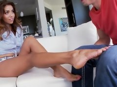 A hot brunette with sexy feet is getting her pussy penetrated