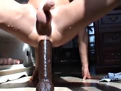boy fucks big black dildo