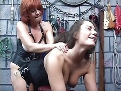 Lesbian with tattoo on gear gets her tits sucked then gives strap on toy have an intercourse