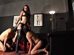 larissa gold plays with two of her slaves
