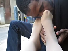 Guy sniffing latinas feet on the street