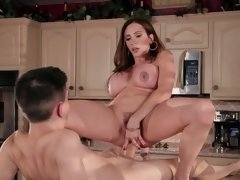 A busty whore that loves cock is getting fucked in the kitchen