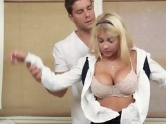 A blonde with large tits is getting a really hot and sexy massage