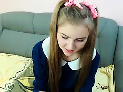 Blonde cutie with pigtails takes off her shirt to reveal a