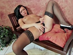 hot brunette in sexy stockings masturbating