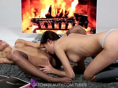 Teen Lesbians Playing By A Fireplace
