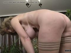 Granny with big hooters has solo fun with a dildo