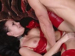 A hot blonde and brunette do some loving in the dungeon in a threesome