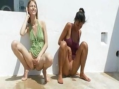 A pair of hot babes urinating in public