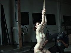 Bondage sub hogtied as prep for whipping
