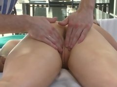 Woman gets her ass fingered while she is on the massage table