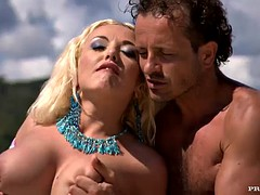 intense sex on the beach with a busty blonde