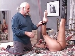 Brunette slut gets her  nipples pinched while she bounded and plus gagged