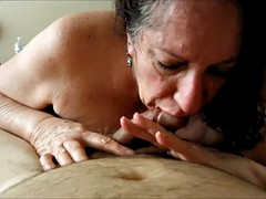 Brunette grandma eating dick