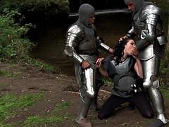 Fearless warrior Petra Stingrey pleasures two cocks