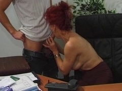Hot European Mature Redhead Gets down and dirty In Office