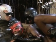 Ebony in leather gets double penetration