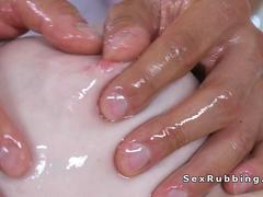 Masseur in pants rubbing naked busty blonde