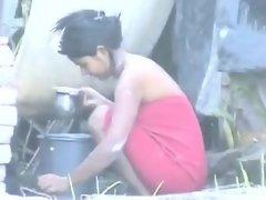 Indian Girl Washing Outdoors