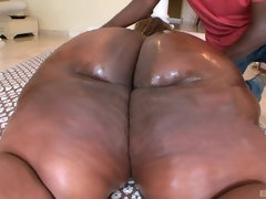 Obese Black Fatty gets her fat ass massaged - amateur porn