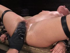 Naked blonde is being chained and tortured with orgasms